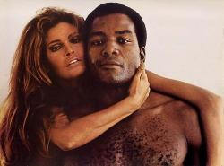 Raquel welch and jim brown in a pubilicty still for 100 rifles