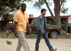 Denzel Washington and Mark Wahlberg in 2 Guns.