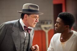 Harrison Ford as Branch Rickey and Chadwick Boseman as Jackie Robinson in 42.