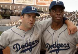 Lucas Black and Chadwick Boseman as Pee Wee Reese and Jackie Robinson in 42.