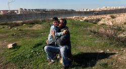 Emad Burnat with his son, Gibreel, in 5 Broken Cameras.