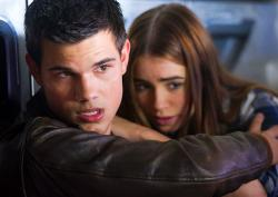 Taylor Lautner and Phil Collins' daughter Lily Collins in Abduction.
