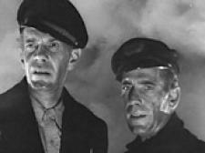 Raymond Massey and Humphrey Bogart in Action in the North Atlantic.