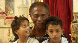 Anwar Congo and two of his grandsons in The Act of Killing.