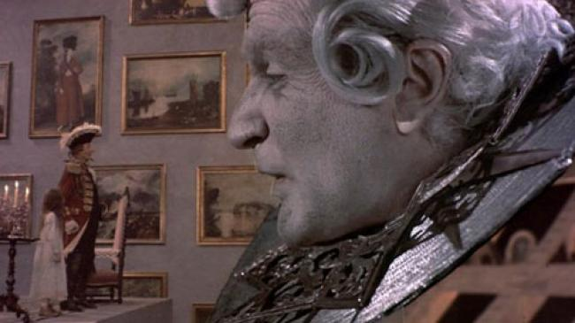Sarah Polley, John Neville and Robin Williams's head in The Adventures of Baron Munchausen.