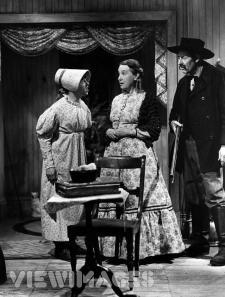 Mickey Rooney as Huck Finn in drag.