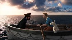 Captain Haddock (voiced by Andy Serkis) and Tintin (voiced by Jamie Bell) and Snowy the dog in The Adventures of Tintin.