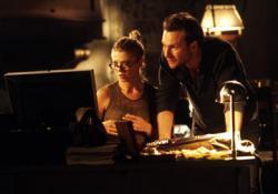 Tara Reid and Christian Slater in Alone in the Dark.