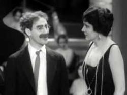 Groucho Marx and Margaret Dumont.