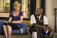 Amy Poehler and Romany Malco.