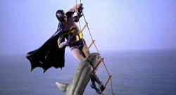 Adam West battles a shark as Batman,but luckily has some Bat-Shark Repellent available.