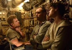 Branwell Donaghay, Jude Law and Bobby Schofield in Black Sea.