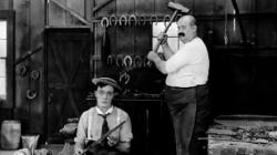 Buster Keaton and Joe Roberts in The Blacksmith.