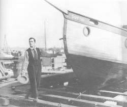 Buster proudly launches his boat.