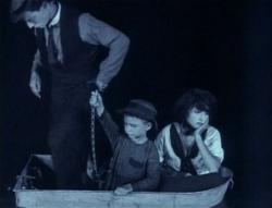 Buster Keaton watches his dreams of boat ownership go down the drain in The Boat.