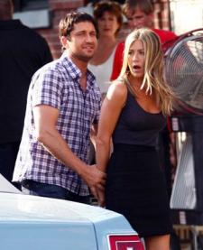 Gerard Butler and Jennifer Aniston got paid to have fun.   I paid, and was bored.