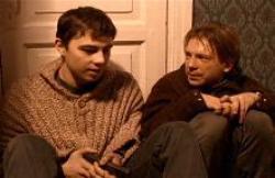 Danila and a nervous hostage.