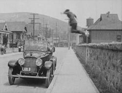 Harold Lloyd leaps into action in Bumping into Broadway.