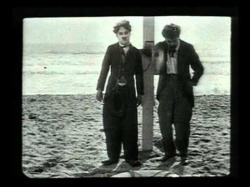 Charlie Chaplin and Billy Armstrong in By the Sea.