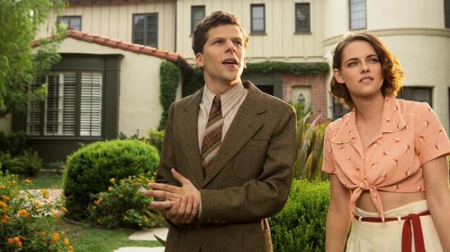 Jesse Eisenber and Kristen Stewart in Cafe Society.