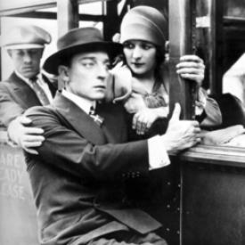 Buster Keaton rides outside the bus in The Cameraman.