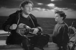 Spencer Tracy and Freddie Bartholomew in Captains Courageous.