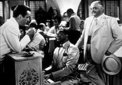 Humphrey Bogart, Dooley Wilson and Sydney Greenstreet in Casablanca.