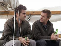 Colin Farrell and Ewan McGregor have a beer while sailing on Cassandra's Dream.