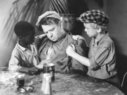 Jesse Scott, Wallace Beery, and Jackie Cooper in The Champ.