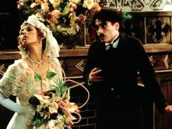 Marisa Tomei and Robert Downey Jr. as Mabel Normand and Charles Chaplin.