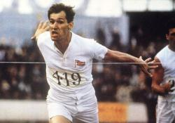 Ben Cross, as Harold Abrahams, crosses the finish line in Chariots of Fire.