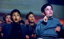 Salvatore discovers the magic of the movies in Cinema Paradiso.