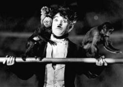 Charlie Chaplin and several monkeys in The Circus.