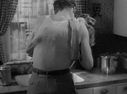 Robert Ryan and Barbara Stanwyck give in to their passion in Clash by Night.