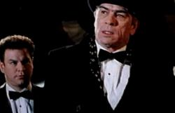 Robert Wuhl and Tommy Lee Jones in Cobb.
