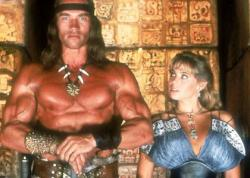 Arnold Schwarzenegger and Olivia d'Abo in Conan the Destroyer.