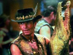 Paul Hogan makes his entrance as Crocodile Dundee  with one of his namesake mates.