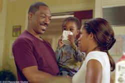 Eddie Murphy and Regina King in Daddy Day Care.