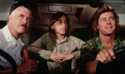 George Peppard, Jackie Earle Haley and Jan-Michael Vincent drive down Damnation Alley.