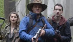 Keri Russell, Jason Clarke, and Kodi Smit-McPhee in Dawn of the Planet of the Apes.
