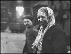 A boy and woman coal workers.