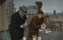 Spencer Tracy and Katharine Hepburn in Desk Set.