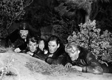 Alan Hale, Ronald Reagan, Errol Flynn, and Arthur Kennedy on a desperate journey.