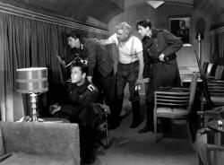 Errol Flynn, Ronald Reagan, Alan Hale and Ronald Sinclair hitch a ride in Goring's personal train car in Desperate Journey.