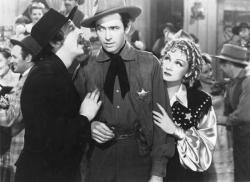 Mischa Auer, James Stewart, and Marlene Dietrich in Destry Rides Again.