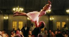 Jennifer Grey, having the time of her life, as Patrick Swayze tries not to drop her.