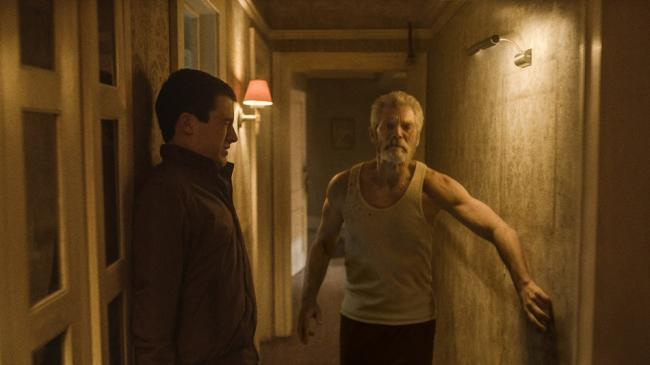 Dylan Minnette and Stephen Lang in Don't Breathe