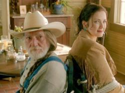 Willie Nelson and Lynda Carter in The Dukes of Hazzard.