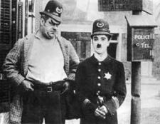 Eric Campbell and Charles Chaplin in Easy Street.