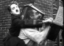 Charlie Chaplin finds a creative way to deal with a bully in Easy Street.